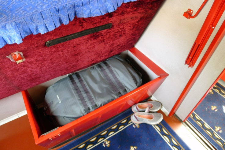 Storage space under the bed or seat of the chinese train.